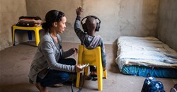 A community health worker screening a child's hearing in Cape Town. Ora Buerkli