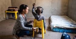 A community health worker screening a child's hearing in Cape Town. Ora Buerkli