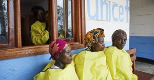 Unicef carers at a creche for children whose parents are being treated for Ebola. Building health infrastructure is crucial to stopping the next outbreak. Epa/ Hugh Kinsella Cunningham