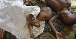 Millions of young children get malaria. These two got it in 2010. AP Photo/Schalk van Zuydam