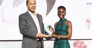 Nila Yasmin, APO Group African Women in Media Award Winner receiving the APO Group African Women in Media Award from Nicolas Ponpigne-mognard, founder and chairman, APO Group