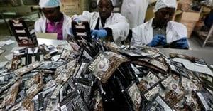 Workers pack coffee sachets at the Dormans coffee factory in Nairobi, Kenya. Credit: The Conversation Africa/EPA/Daniel Irungu.