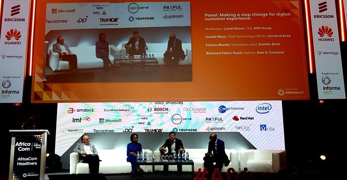 The digital CX keynote at AfricaCom. Moderated by Lionel Reina, CEO of the APO Group; the panel included Unathi Mtya, CTO at Grindrod Bank; Bertrand Fallon-Kund, partner at Bain & Company; and Francis Mumbi, innovation lead at Stanbic Bank.
