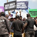 Demonstrators are seen outside the Department of State Services headquarters in Abuja, Nigeria, on November 12, 2019. Police fired on and attacked journalists covering that demonstration. Credit: CPJ/AFP/Kola Sulaimon.