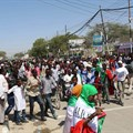People take part in a parade to mark the 24th self-declared independence day for the breakaway region of Somaliland in the capital Hargeisa on May 18, 2015. On November 18, 2019, Somaliland police shut down a TV station and arrested its editor. Credit: CPJ/Reuters/Feisal Omar.