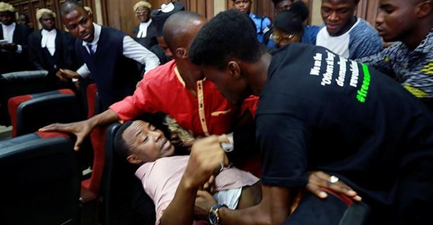 Police officers detain Sahara Reporters journalist Victor Ogungbenro during a protest in Lagos, Nigeria, on August 5, 2019. Staff at the online newspaper report sustained harassment targeting them and their website. Credit: CPJ/AP/Sunday Alamba.
