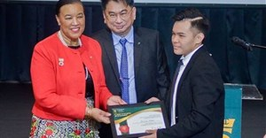 Secretary-General Patricia Scotland presenting Choo with his award.