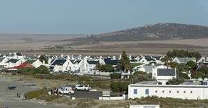 The view looking east across the West Coast with the village of Paternoster in the foreground. The recently approved Boulders Wind farm will stand on the hills in the background, directly in this view. Photo: John Yeld