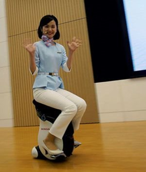 A Honda employee demonstrates a personal mobility device developed by the car maker. Franck Robichon/EPA