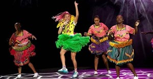 Sho Madjozi with her xibelani dancers on stage at Design Indaba 2020. Image by Garth von Glehn, via Design Indaba's