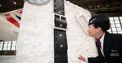 Eco-artist Sarah Turner's giant suitcase made of plastic is on display at Heathrow.