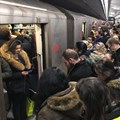 Commuters jam a Toronto subway platform. Widespread adoption of habits that help prevent infection may boost behavioural herd immunity.