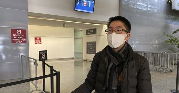 Bill Chen at San Francisco International Airport after arriving on a flight from Shanghai. Chen said his temperature was screened at the Shanghai airport before he departed.<br>AP Photo/Terry Chea