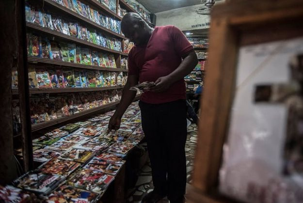 A customer looks at some Nollywood movies in a shop at Idumota market in Lagos. Cristina Aldehuela/AFP/Getty Images.