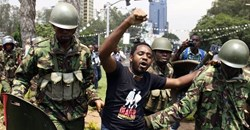 Kenyan activist Boniface Mwangi is arrested during a protest in Nairobi in 2014. AFP via Getty Images.