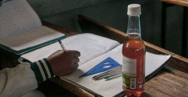 A bottle of Covid Organics, a herbal tea that authorities in Madagascar gave to students. Photo by Rijasolo/AFP via Getty Images