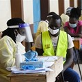 Healthcare workers testing people in Nairobi, Kenya during a mass testing exercise for Covid-19. Photo by SIMON MAINA/AFP via Getty Images