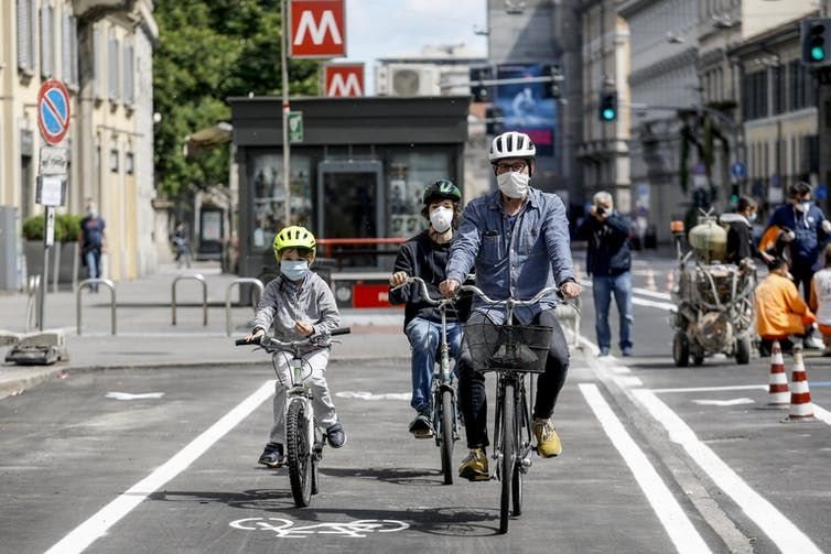 A family travels on a new bike path opened during lockdown in Milan, Italy.