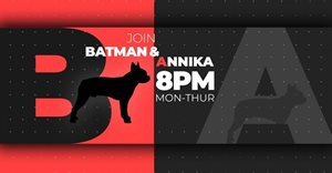 Annika Larsen has a new co-anchor, and his name is Batman!