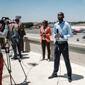 TV reporters prepare for a live broadcast during a strike by airline workers in Nairobi. Yasuyoshi Chiba/AFP via Getty Images.
