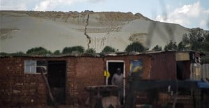 Grootvlei, Snake Park, an impoverished suburb on the fringe of one of the biggest mine dumps in Soweto, Johannesburg. Poor people have been hit hardest by the fallout of Covid-19. Mujahid Safodien/AFP via Getty Images