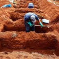 Gravediggers are exhuming old graves in Brazil to open new spaces. Brazil is currently second in the world for cases and deaths, and many consider it the new global epicentre. Sebastiao Moreira/EPA