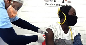 A volunteer receives an injection from a medical worker during the country's first human clinical trial for a potential vaccine against Covid-19 in Soweto, South Africa. Felix Dlangamandla/Beeld/Gallo Images via Getty Images
