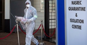 A healthcare worker in a protective suit is seen at a quarantine and isolation centre in Johannesburg, South Africa.