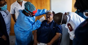 A nurse demonstrates how to perform a swab test in Johannesburg, South Africa. Michele Spatari / AFP via Getty Images