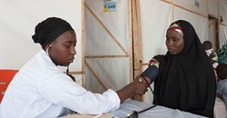 A woman gets her blood pressure checked at a camp for internally displaced people in Maiduguri, north-east Nigeria. Stefan Heunis/AFP via Getty Images