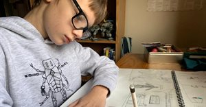 Young robot designer inspires learners with sanitiser superhero