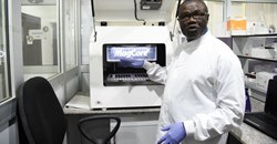 Professor Christian Happi, director of the African Centre of Excellence for Genomics of Infectious Diseases, displays one of the most advanced automated acid extractors being used in the laboratory. Pius Utomi Ekpei/AFP via Getty Images