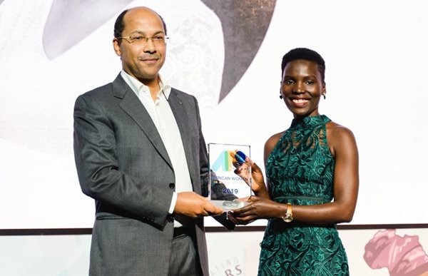 APO Group African Women in Media Award winner Nila Yasmin receiving the APO Group African Women in Media Award 2019 from Nicolas Pompigne-Mognard, founder and chairman, APO Group