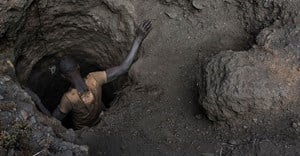 A creuseur or digger, descends into a tunnel at the mine in Kawama, Democratic Republic of Congo. Michael Robinson Chavez/The Washington Post via Getty Images