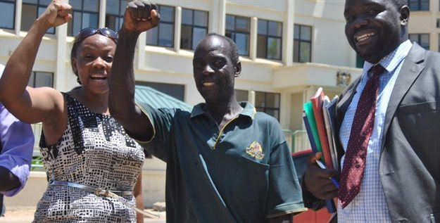 Phyllis Omido on the left, one of the lead poisoning victims, and her lawyer at the Mombasa law court after winning the case. Image © Christabel Ligami