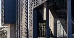 Black brick, off-shutter concrete, glass used in Commerce Crescent construction