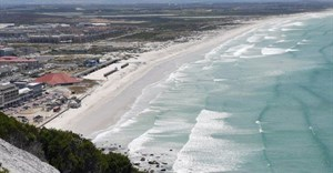 Muizenberg beach is eerily quiet on a hot summer's day, 29 December 2020. If we want to save lives and life to go back to normal we need to embrace vaccines.