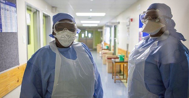 Nurses in the isolation unit at Tygerberg Hospital in the Western Cape. Misha Jordaan/Gallo Images via Getty Images