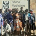 Litigation consultant, Zolile Shude, (far right) is concerned about the repeated postponement of the trial of five men who allegedly took part in attacks on people opposed to the Xolobeni Mineral Sands Project on the Wild Coast in December 2015. He is pictured here with victims and family members. Photo: Fred Kockott