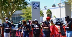 Workers protest outside Volkswagen South Africa's main plant on Wednesday. They were demanding that 14 fired shop stewards be reinstated. Photo: Thamsanqa Mbovane/ GroundUp