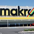 A worker walks beneath a logo at Makro Store Riversands of South African retailer Massmart in Midrand, South Africa, August 28, 2019. Reuters/Siphiwe Sibeko/File Photo