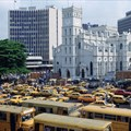 Bank buildings rise above the business district of Lagos. Banks must effectively communicate the impact of their engagement with women. Tim Graham/Getty Images