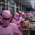 Workers at India's biggest syringe manufacturer ramp up production in September 2020 in race to meet Covid-19 vaccine-driven demand. Photo by SAJJAD HUSSAIN/AFP via Getty Images