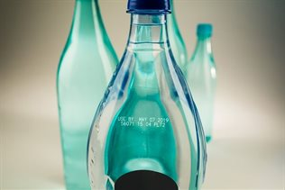 Meeting required standards for coding on plastic bottles