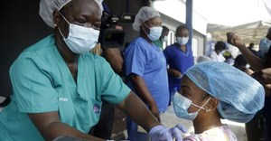 Hospital staff in Lagos, Nigeria, administer the AstraZeneca vaccine. AP Photo/Sunday Alamba