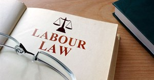 Can the Labour Court determine review proceedings of a liquidated company?