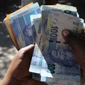 A street money changer counts South African rands in Harare, Zimbabwe, file. Reuters/Philimon Bulawayo