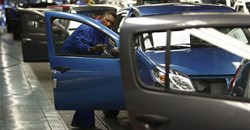 A worker inspects cars at Nissan's manufacturing plant in Rosslyn, outside Pretoria, file. Reuters/Siphiwe Sibeko