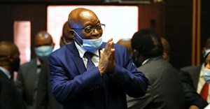 South Africa's former President Jacob Zuma, who is facing fraud and corruption charges, greets supporters in the gallery of the High Court in Pietermaritzburg, South Africa, May 17, 2021. Reuters/Rogan Ward