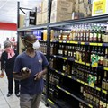 A shopper wearing a protective mask shops for liquor in Johannesburg, South Africa, March 26, 2020. Reuters/Siphiwe Sibeko